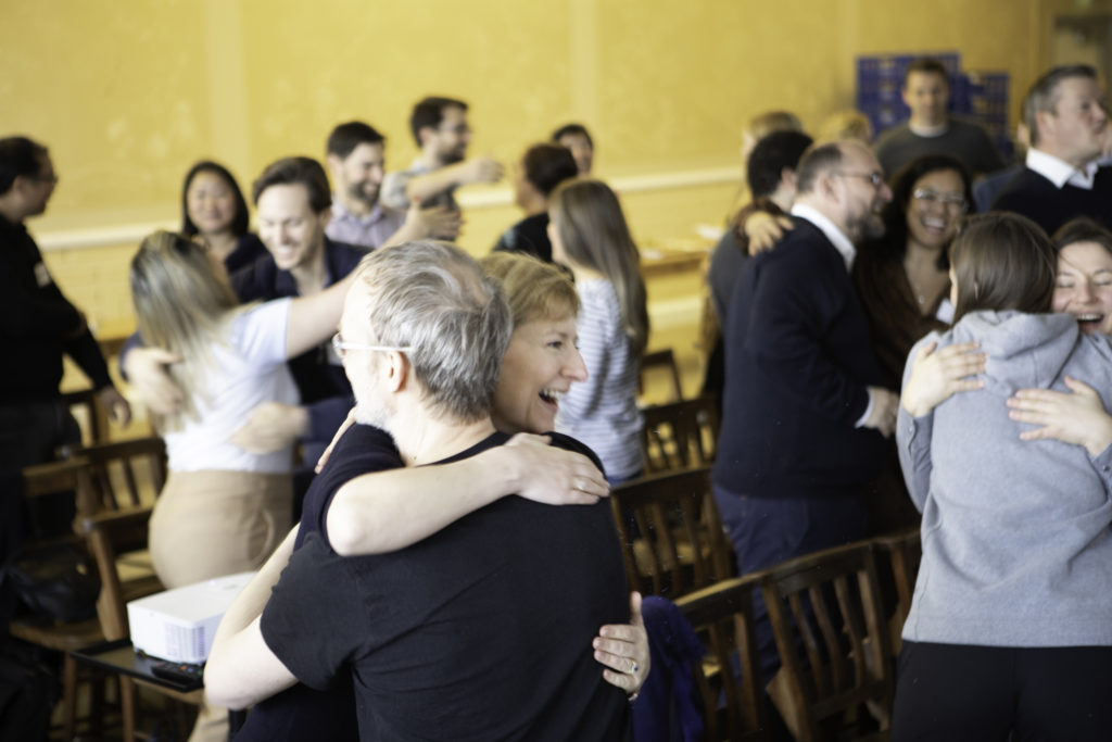 Participants hugging in Doha